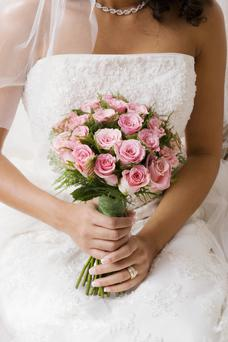 Six in ten single women have carried out research into dresses, flowers and reception venues despite still being on the quest to find Mr Right. (Stock photo)