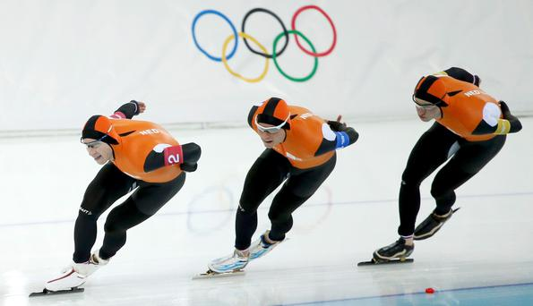 Team Netherlands: (L-R) Jan Blokhuijsen, Sven Kramer, and Koen Verweij compete in the men's speed skating team pursuit gold-medal final during the 2014 Sochi Winter Olympics