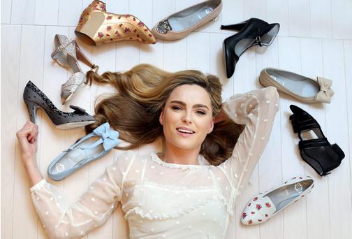 Model Sarah Morrissey pictured with some of the shoes from the Rayne collection which part of the Rayne shoes pop up at Brown Thomas yesterday.