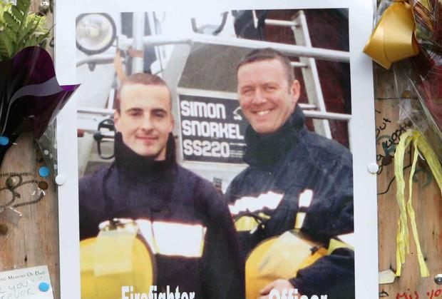 A photo of firemen Mark O'Shaughnessy and Brian Murray at the scene during a memorial service to mark the first anniversary of the tragedy