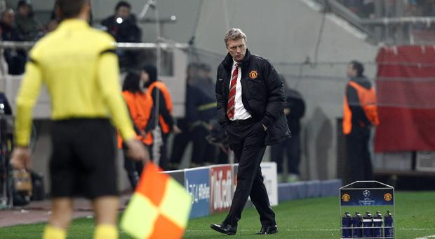 Manchester United's coach David Moyes reacts during a Champions League round of 16 first leg soccer match against Olympiakos