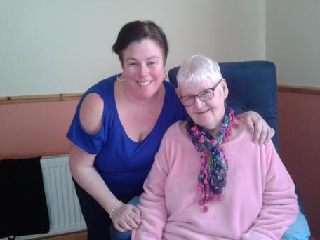 Eileen Kilcoyne and her daughter Kelly Denning in their home, which Eileen hasn't left in three years.