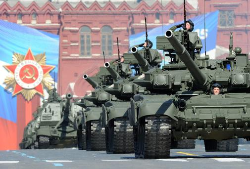 A column of Russian T-90 tanks rolls through the Red Square in Moscow during the Victory Day parade in May 2013