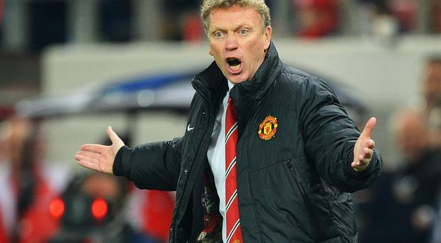 Manchester United manager David Moyes reacts on the touchline during the UEFA Champions League match between Olympiacos FC and Manchester United