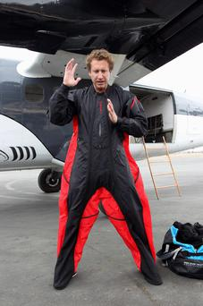Wingsuit jumper Joby Ogwyn shows reporters his prototype wingsuit before taking a practice jump as he prepares to attempt the first wingsuit jump off the summit of Mount Everest