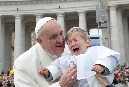 19-month-old Daniele De Sanctis, dressed up as a pope, is handed to Pope Francis as he is driven through the crowd during his weekly general audience in St. Peter's Square. Photo: AP Photo/L'Osservatore Romano
