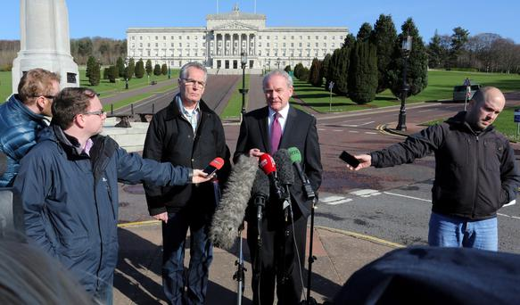 Deputy First Minister Martin McGuinness (right) with Gerry Kelly Sinn Fein MLA speaking to the media at Parliament buildings, Stormont