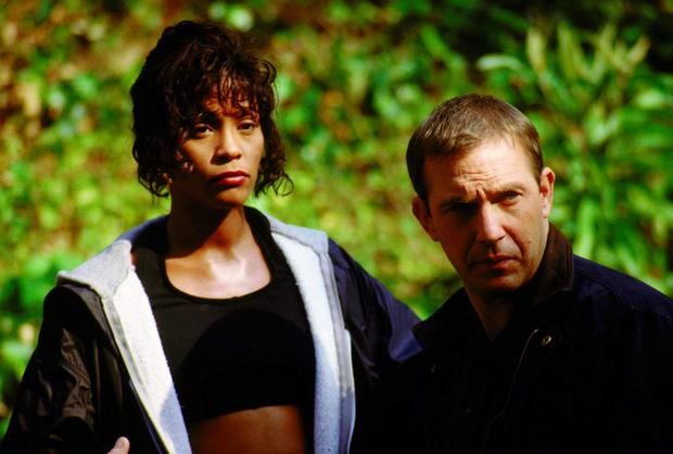 Whitney Houston and Kevin Costner are shown in a scene from their 1992 film