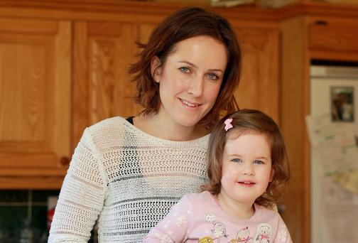 Andrea Weldon and her daughter Tamara, 2, with one of her specially designed cakes at home in Aughrim Co. Wicklow