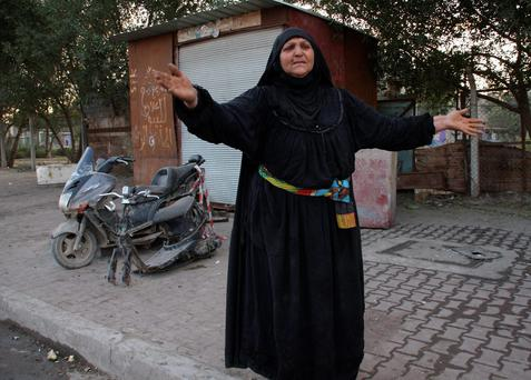 A woman reacts at the site of a bomb attack in Sadr city, Baghdad