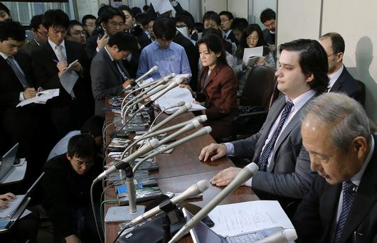 Mt. Gox CEO Mark Karpeles, sitting at second right, attends a press conference at the Justice Ministry in Tokyo