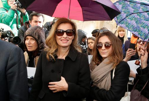 Valerie Trierweiler, centre, former companion of French President Francois Hollande, leaves after Dior's AW 2014 show in Paris