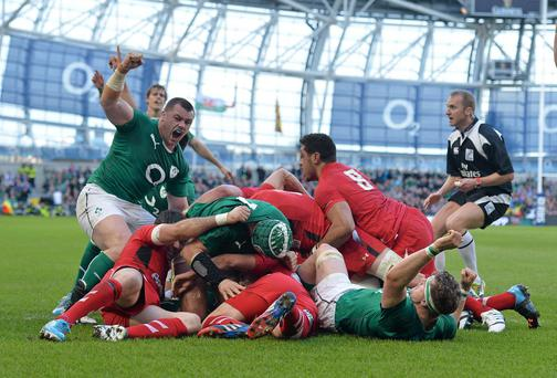 Cian Healy, Ireland, celebrates after team-mate Chris Henry scores