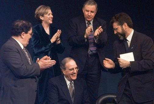 The way we were: Peace process hero US Senator George Mitchell, centre, smiles as he is applauded by fellow recipients of the John F Kennedy Profile in Courage Award, John Hume, left, of the SDLP and Gerry Adams, during a ceremony in Boston, in 1998. The presentation was to mark the signing of the Good Friday Agreement. Also applauding above was Liz O'Donnell, then Minister of State, and Paul Murphy, Minister of State in the North. AP