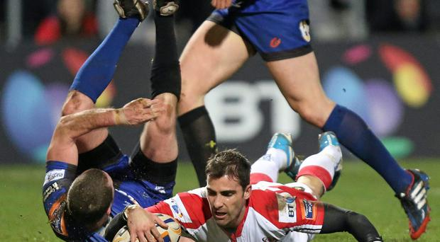 Ulster's Ruan Pienaar goes over to score his sde's first try despite the efforts of the Newport Gwent Dragons defence