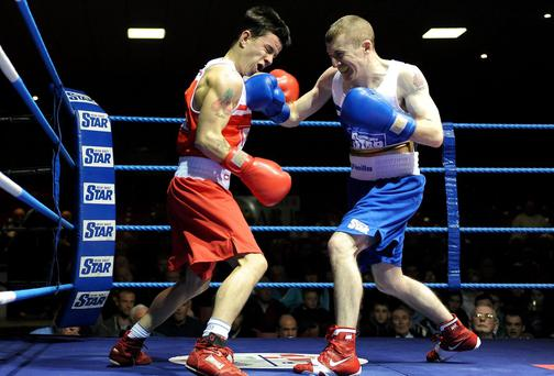 Paddy Barnes, right, exchanges punches with Blaine Dobbins during their IABA Elite National Championship semi-final clash at National Stadium in Dublin
