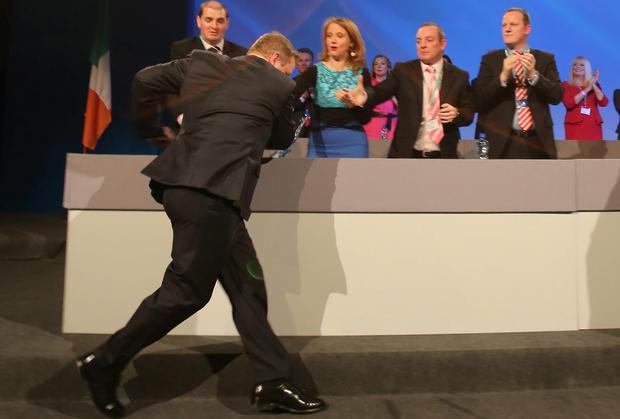 Enda Kenny trips and nearly falls as he arrives on stage at the Fine Gael Ard Fheis. Picture: NIALL CARSON/ PA WIRE