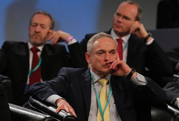 Sean Kelly MEP, Jobs Minister Richard Bruton and Agriculture Minister Simon Coveney listen to Taoiseach Enda Kenny speaking at the Fine Gael ard fheis at the RDS in Dublin.