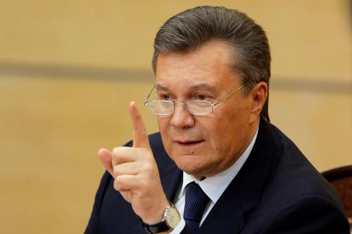 Ousted Ukrainian President Viktor Yanukovich takes part in a news conference