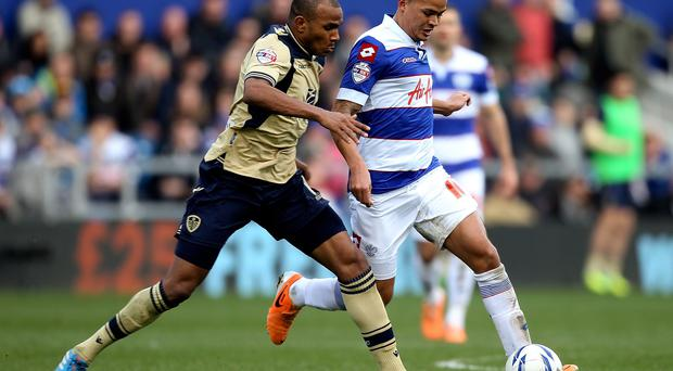 Rodolph Austin of Leeds battles with Jermaine Jenas of QPR during the Sky Bet Championship match between Queens Park Rangers and Leeds United at Loftus Road.