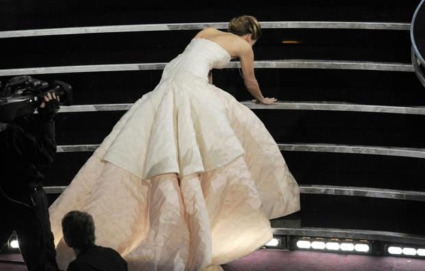 Jennifer Lawrence...Jennifer Lawrence stumbles as she walks on stage to accept the award for best actress in a leading role for