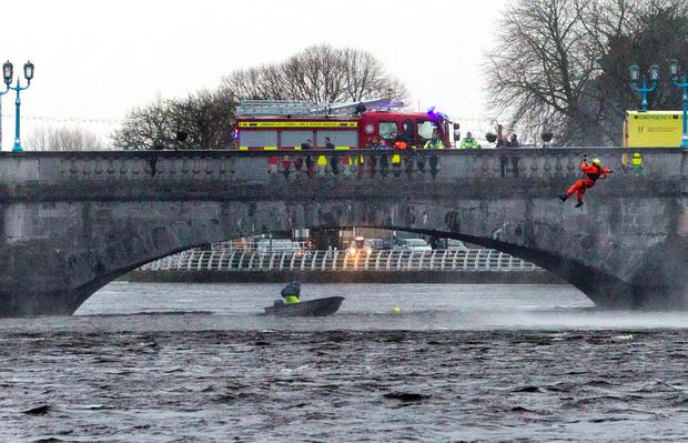 1/3/14 A women entered the water near Sarsfield bridge Limerick City. An immediate rescue operation by Limerick City Fire And Rescue and Rescue 115, the Shannon based rescue helicopter who both entered the water in an effort to safe the women. Pic Sean Curtin Photo.