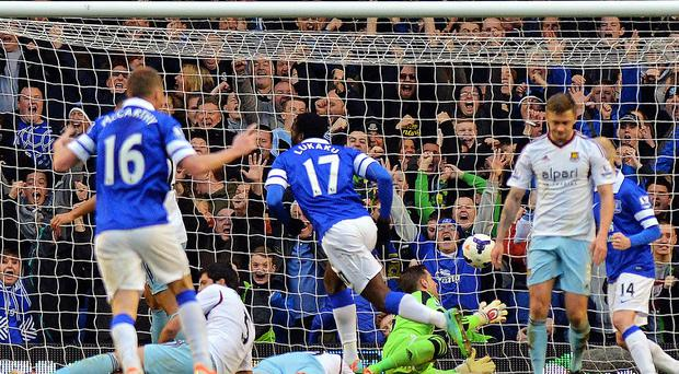 Everton's Belgian striker Romelu Lukaku (4th R) scores his teams first goal