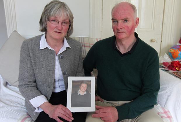 Lucia and Jim O'Farrell hold a picture of their late son, Shane. Picture: Damien Eagers
