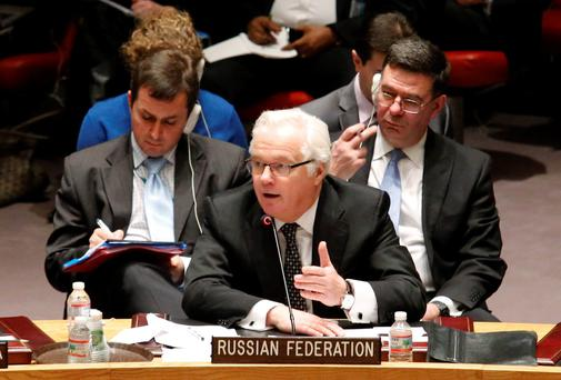 Russian Ambassador to the United Nations Vitaly Churkin (C ) speaks during a security council meeting on the crisis in Ukraine, at the U.N. headquarters in New York March 1, 2014. Reuters.