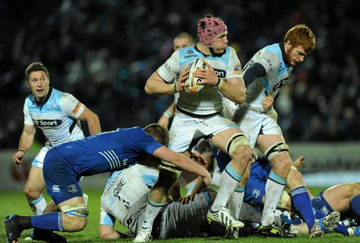 Tim Swinson, Glasgow Warriors, is tackled by Jordi Murphy, Leinster