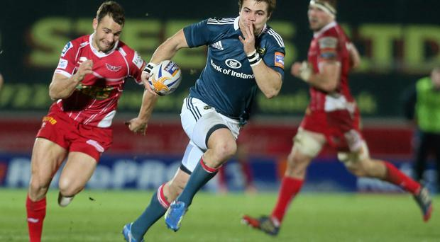 Gerhard Van Den Heever, Munster, races ahead of Olly Barkley, Scarlets to score his side's first try