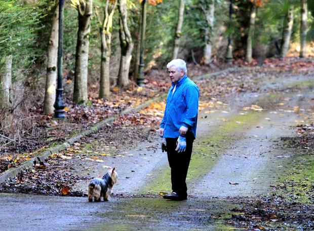 John Gilligan cleans leaves off the driveway of his Jessbrook estate in Enfield, Co Meath, after his release last year