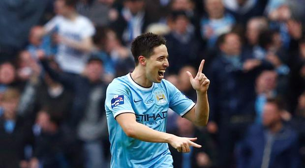 Manchester City's Samir Nasri celebrates after scoring a goal against Sunderland during their English League Cup final at Wembley.