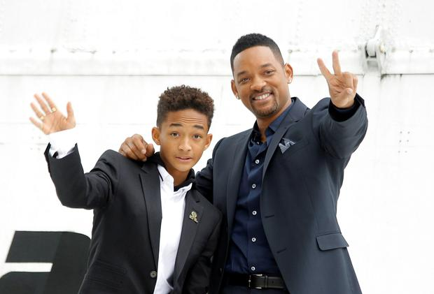 Will Smith and his son Jaden Smith pose for pictures during a photo call to promote their latest movie