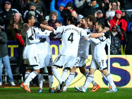 Jonathan de Guzman of Swansea City celebrates scoring the opening goal with team mates against Crystal Palace at the Liberty Stadium.