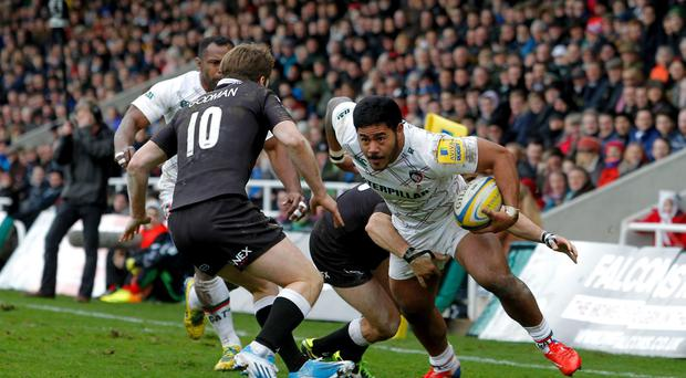 Newcastle Falcons' Phil Goodman and Gonzalo Tiesi challenge Leicester Tigers' Manusamoa Tuilagi