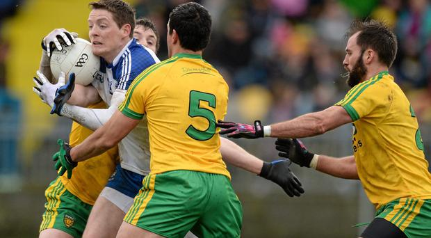 Conor McManus, Monaghan, in action against Leo McLoone, Frank McGlynn and Karl Lacey, Donegal