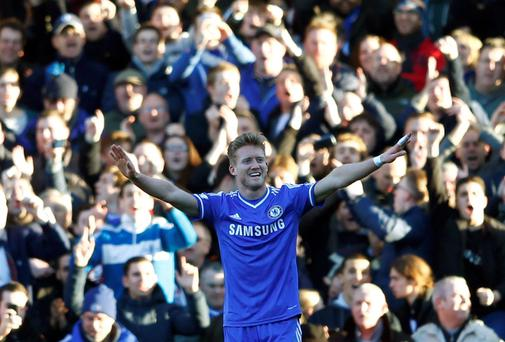 Chelsea's Andre Schurrle celebrates after scoring a hat trick against Fulham