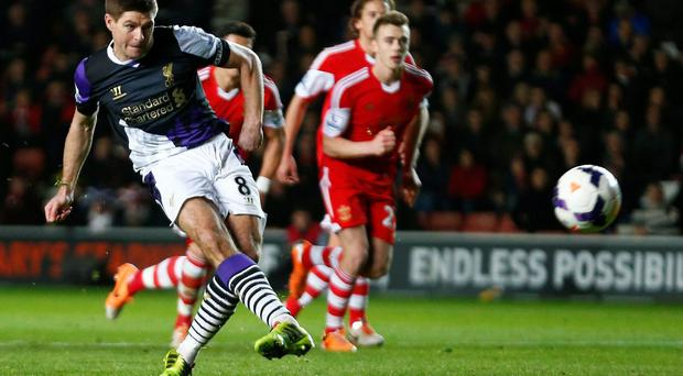 Steven Gerrard of Liverpool scores a penalty against Southampton