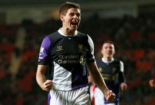 Steven Gerrard of Liverpool celebrates scoring a penalty against Southampton