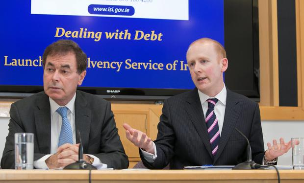 Minister for Justice Alan Shatter with Lorcan O'Connor of Insolvency Service of Ireland