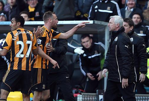 Newcastle United's manager Alan Pardew and Hull City's David Meyler confront each other during the Barclays Premier League match