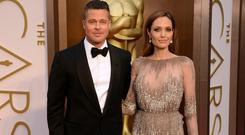 Actors Brad Pitt (L) and Angelina Jolie attend the Oscars held at Hollywood & Highland Center on March 2, 2014 in Hollywood, California. (Photo by Jason Merritt/Getty Images)