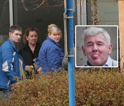 Darren Gilligan (left), Geraldine Gilligan (centre) and family and friends of John Gilligan (inset) outside Connolly Hospital Blanchardstown in Dublin. Picture: COLLINS