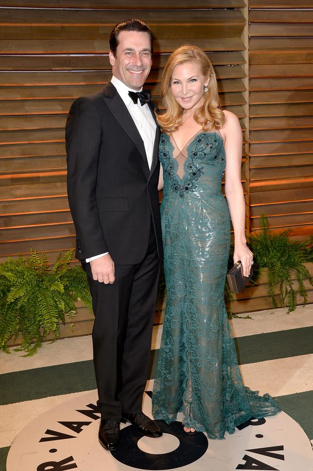 Actors Jon Hamm (L) and Jennifer Westfeldt attend the 2014 Vanity Fair Oscar Party hosted by Graydon Carter on March 2, 2014 in West Hollywood, California. (Photo by Pascal Le Segretain/Getty Images)
