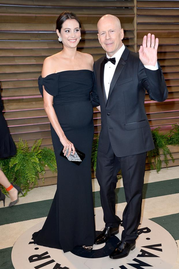 Actor Bruce Willis and model Emma Heming attends the 2014 Vanity Fair Oscar Party hosted by Graydon Carter on March 2, 2014 in West Hollywood, California. (Photo by Pascal Le Segretain/Getty Images)