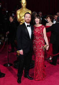 Mchael Fassbender and his mother Adele arriving at the 86th Academy Awards held at the Dolby Theatre in Hollywood, Los Angeles, CA, USA. PRESS ASSOCIATION Photo. Picture date: Sunday March 2, 2014. See PA story SHOWBIZ Oscars. Photo credit should read: Ian West/PA Wire