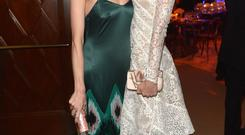 Actress Jaime King (L) and musician Taylor Swift attend The Weinstein Company's Academy Award party hosted by Chopard and DeLeon Tequila (Photo by Charley Gallay/Getty Images for The Weinstein Company)