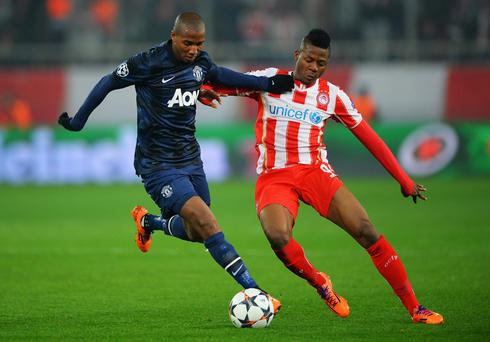 Ashley Young of Manchester United holds off Michael Olaitan of Olympiacos last week