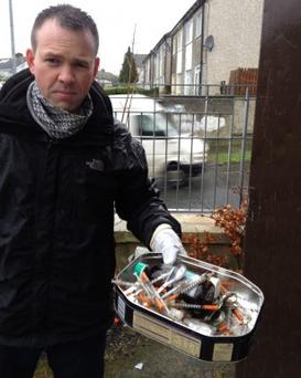 Sinn Fein's John Brady with syringes